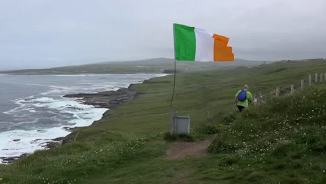 Ireland-County-Clare-View-Along-Coast-With-Irish-Flag-And-Photographer-Zoom-In