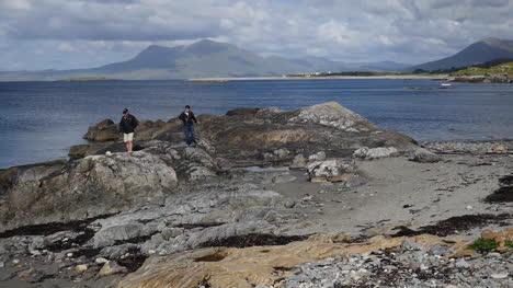 Ireland-County-Galway-Rinvyle-Men-Walking-Along-Rock