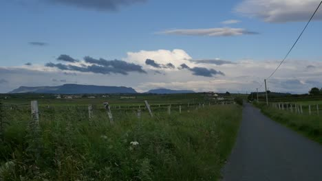 Ireland-County-Sligo-A-Country-Road-With-Distant-Benbulbin