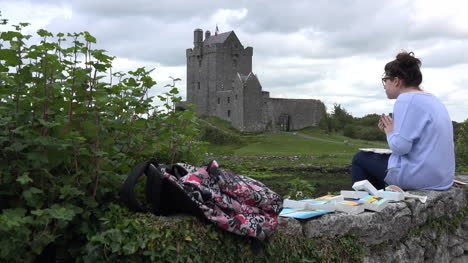 Ireland-Dunguaire-Castle-With-Woman-Painter