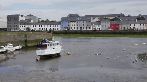 Ireland-Galway-Bay-Boats-At-Low-Tide-With-City-On-The-Opposite-Bank-Pan
