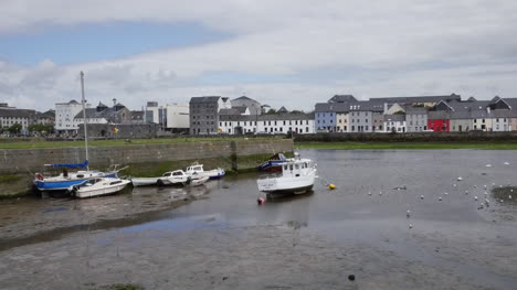 Ireland-Galway-Bay-Boats-At-Low-Tide-With-City-On-The-Opposite-Bank