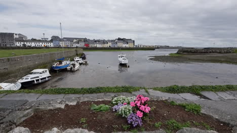 Ireland-Galway-Bay-Boats-At-Low-Tide-With-Flower-By-Walkway
