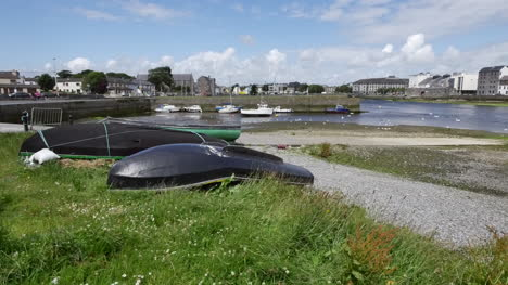 Ireland-Galway-Bay-Boats-Lie-Upside-Down-In-The-Grass-By-The-Shore