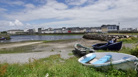 Ireland-Galway-Bay-Men-Work-On-A-Boat-On-The-Bank