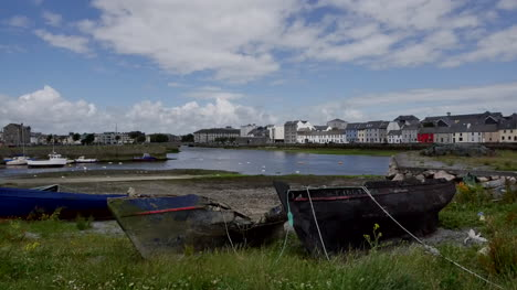 Ireland-Galway-City-Old-Boats-Sit-By-Shore