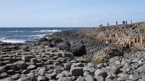 Northern-Ireland-Giants-Causeway-Hexagonal-Stones-And-Tourists-In-Distance