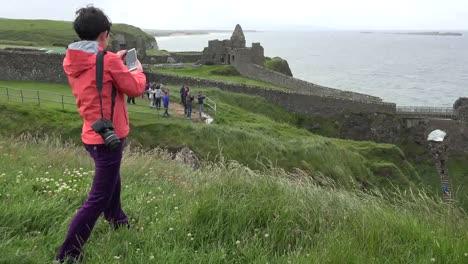 Northern-Ireland-Girl-Photographing-Dunluce-Castle-