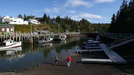 Canada-People-Watching-Tide-Go-Out-