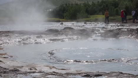 Iceland-Haukadalur-Strokkur-Geyser-Erupts-Then-Water-Goes-Into-Vent-Pan