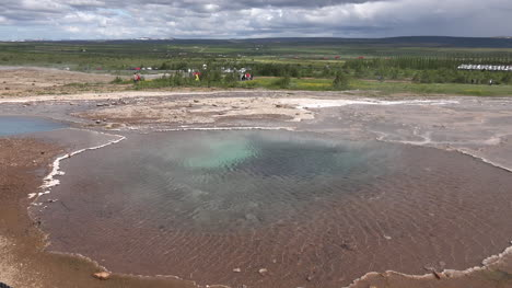 Iceland-Haukadalur-Geyser-Basin-Pool-With-Distant-Landscape