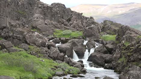 Iceland-Pingvellir-Small-Waterfall-On-Stream