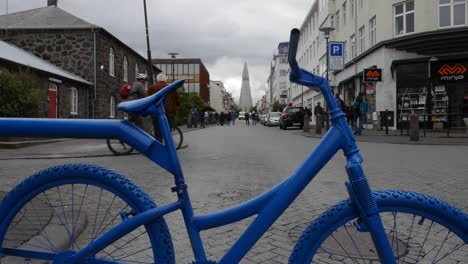 Iceland-Reykjavik-Bicycle-Frames-Street-Scene-With-Church