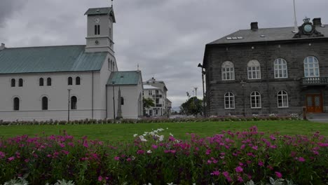 Iceland-Reykjavik-Stone-Building-And-Church-With-Flowers
