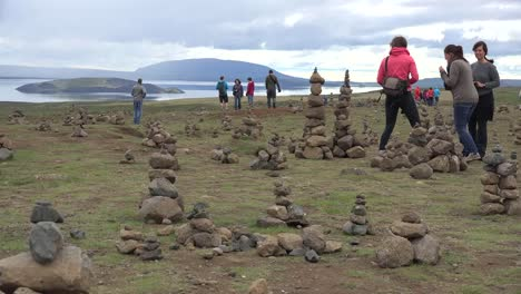 Iceland-Landscape-With-Cairns-And-Woman-In-Orange