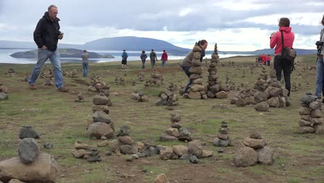 Iceland-Landscape-With-Cairns-And-Woman-Taking-A-Picture