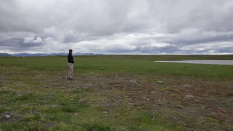 Iceland-Man-Standing-Under-Cloudy-Sky