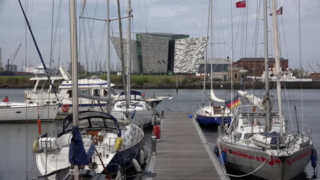 Northern-Ireland-Belfast-Titanic-Museum-And-Boats-In-Marina-With-Man-