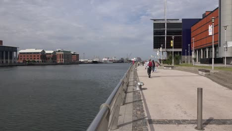 Northern-Ireland-Belfast-Walkers-Along-Queens-Quay-And-Odyssey-Pavilion-