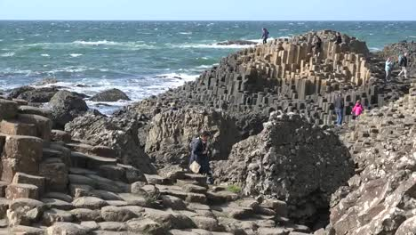 Northern-Ireland-Giants-Causeway-People-Exploring-At-Site-Zoom-And-Pan-