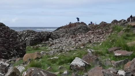 Northern-Ireland-Giants-Causeway-Shore-With-Man-On-Rock-Zoom-In