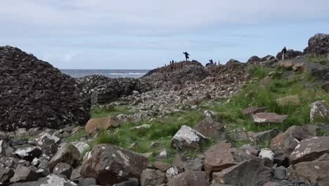 Northern-Ireland-Giants-Causeway-Shore-With-Man-On-Rock