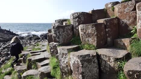 Northern-Ireland-Giants-Causeway-Tourists-Walk-Past-Hexagonal-Stones