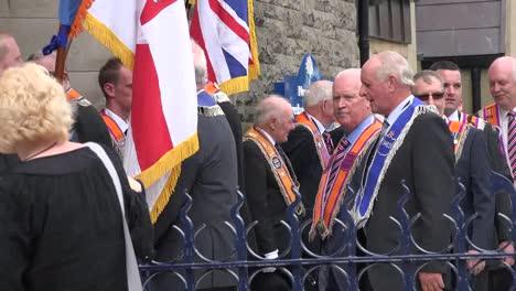 Northern-Ireland-Orangemen-Waving-To-Onlooker-By-Church