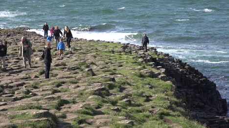 Northern-Ireland-Basalt-Columns-People-Walking-Up-Giants-Causeway-