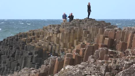 Northern-Ireland-Tourist-Standing-On-Giants-Causeway