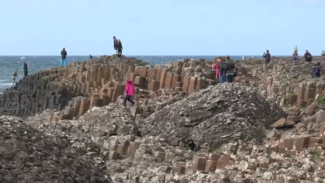 Northern-Ireland-Tourists-Standing-On-Giants-Causeway-Pan-
