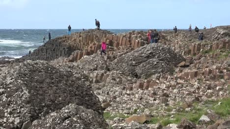 Northern-Ireland-Tourists-Standing-On-Giants-Causeway-