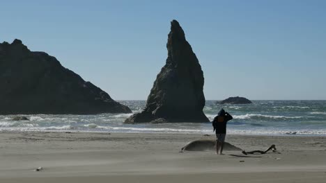 Oregon-Boy-By-A-Sea-Stack