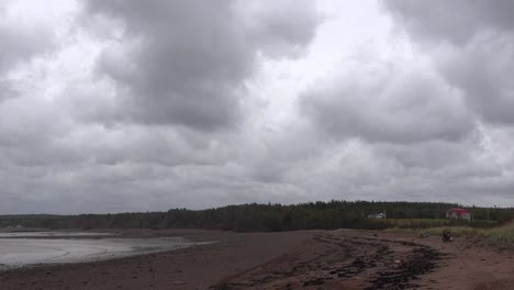 Canada-Bay-Of-Fundy-Beach-And-Cloudy-Sky-Time-Lapse-Pan