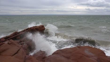 Canada-Bay-Of-Fundy-Waves-Break-On-Red-Rocks