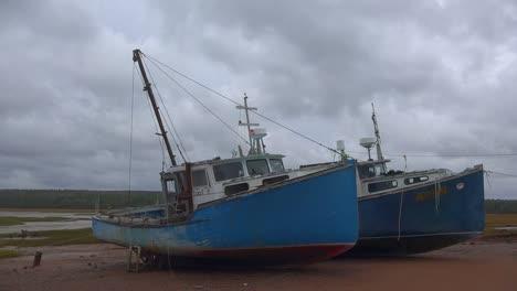 Canada-Nova-Scotia-Blue-Boats-At-Low-Tide