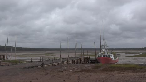Canada-Nova-Scotia-Boat-By-Dock-At-Low-Tide-Zoom-And-Pan