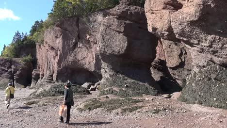 Canada-Tourists-Walk-By-Cliffs