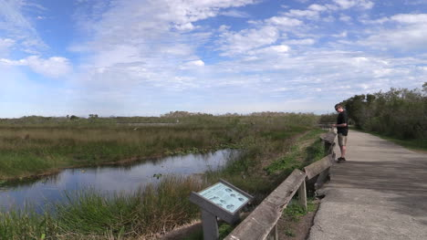 Florida-Everglades-Grass-And-Water-Man-On-Path-Takes-Picture-Editorial