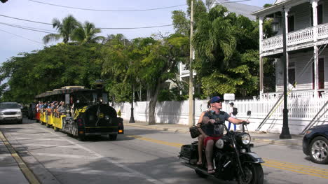 Florida-Key-West-Street-With-Tourists-On-Open-Trolley-Editorial