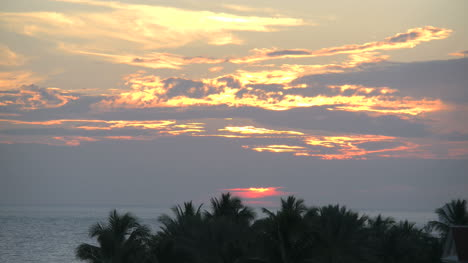 Florida-Key-West-Sunset-Through-Clouds-Over-Palms