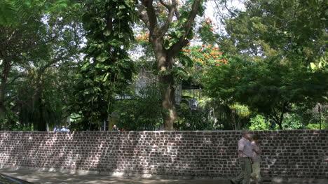 Florida-Key-West-Tourists-Walk-Past-Wall-Around-Hemingway-House