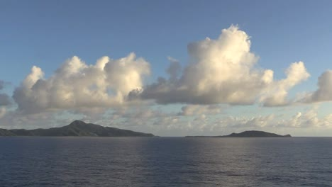 American-Samoa-In-The-Distance-Under-Clouds