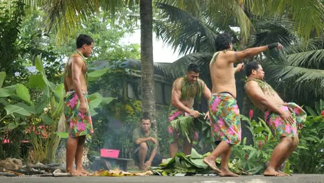 American-Samoa-Village-Men-Dancing-And-Cooking-With-Banana-Leaves