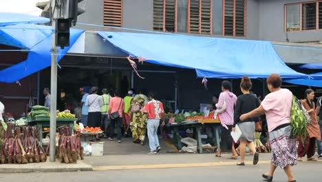 Fiji-Suva-People-Walk-Toward-A-Market