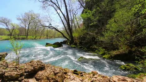 Missouri-Current-River-Flows-Past-Rocks-At-Big-Spring