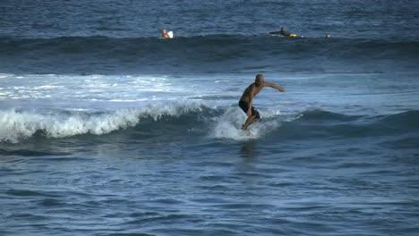 Oahu-A-Surfer-Rides-A-Wave-