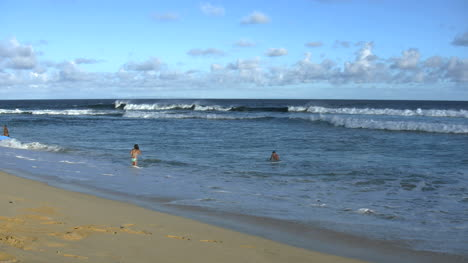 Oahu-Sandy-Beach-Playing-In-Surf