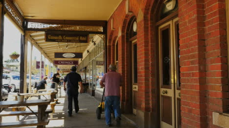 Australia-Beechworth-People-Walking-By-Shops