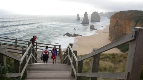 Australia-Great-Ocean-Road-12-Apostles-Tourists-On-Boardwalk-Climb-Steps